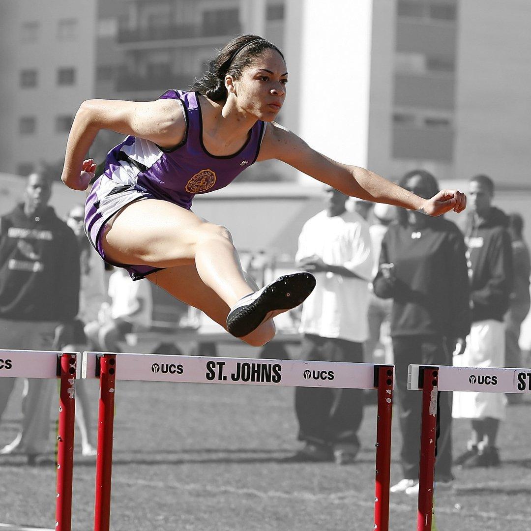 female hurdler during track meet