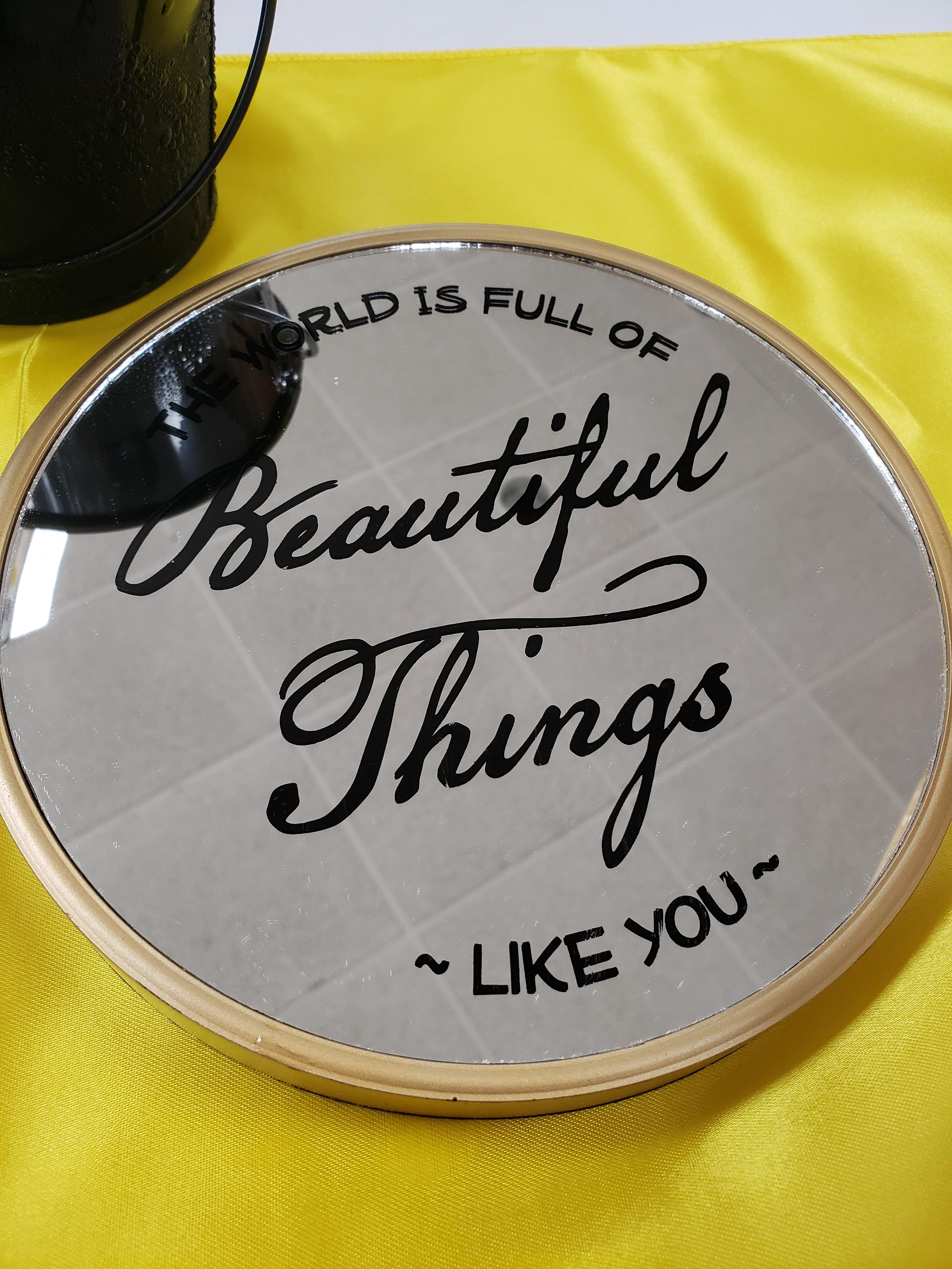 "fancy dinner plate with the words ""the world is full of beautiful things like you"" by Melissa Presser"