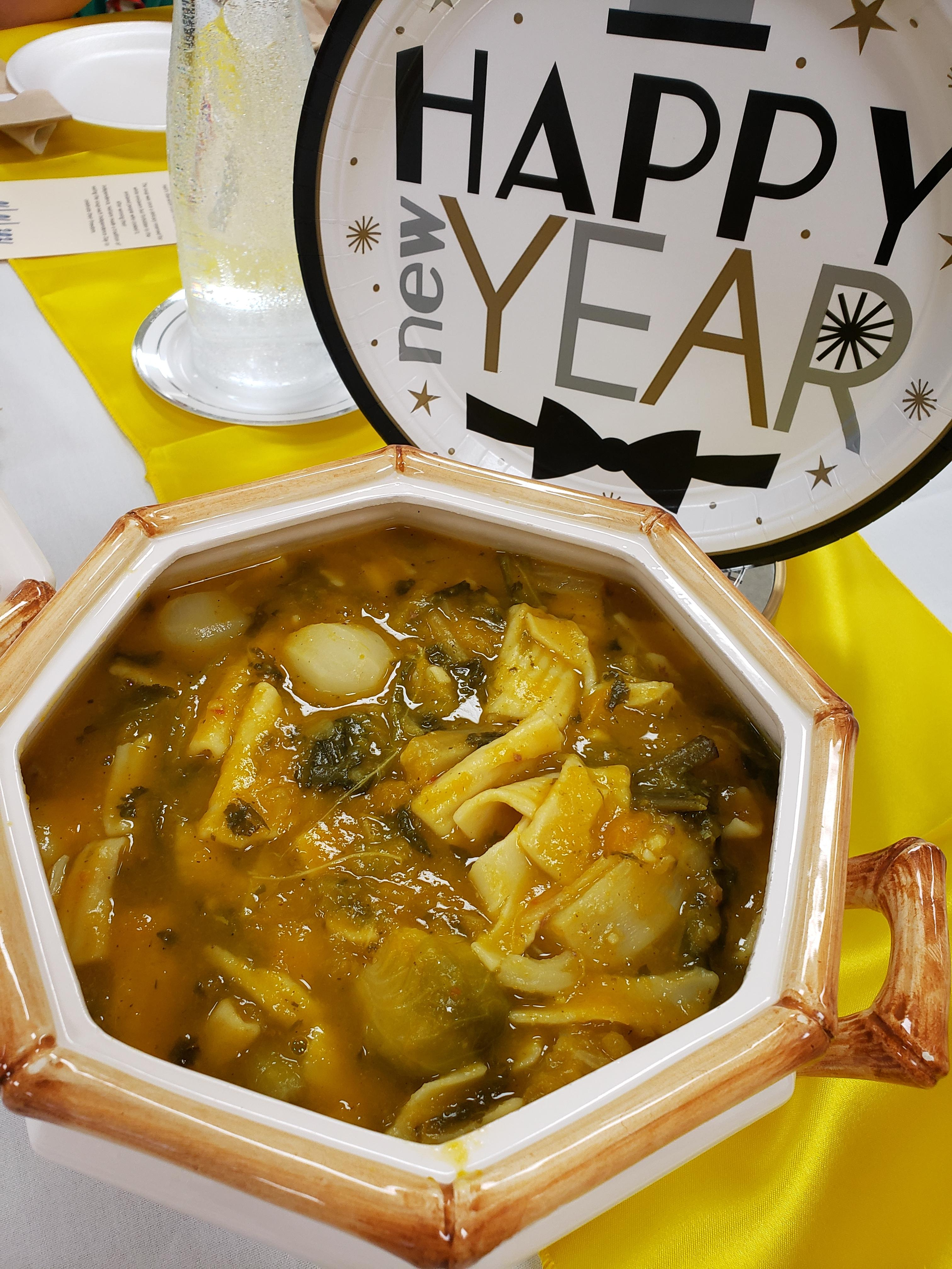"Serving bowl of soup with ""Happy New Year"" decorations by Melissa presser"