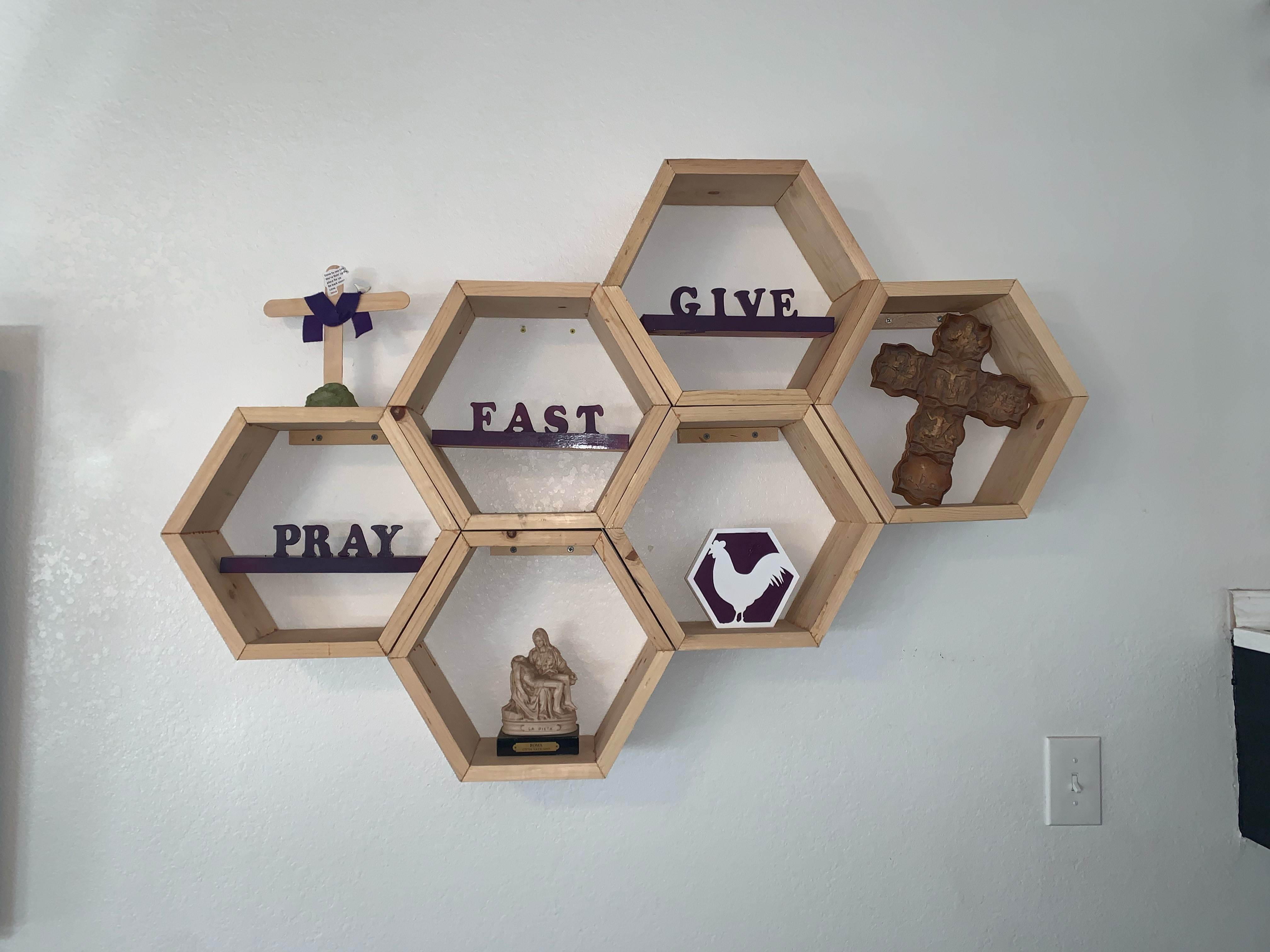 Lent wooden honeycomb boxes with pray fast give words and related objects