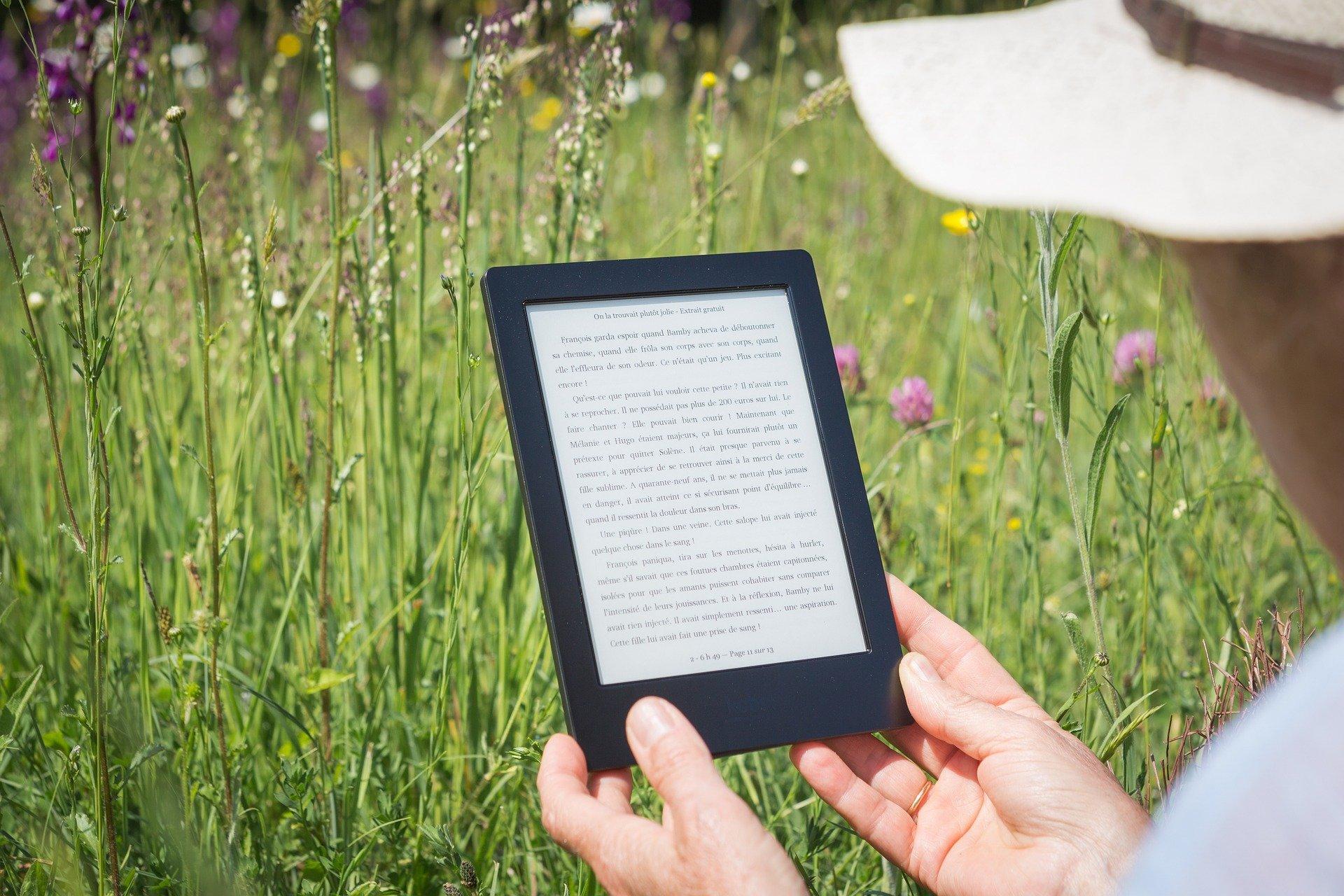 Person using e-reader outdoors