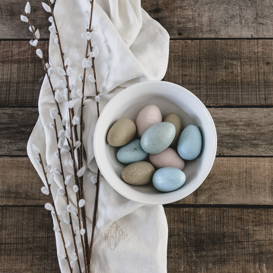 bowl of Easter eggs, pussy willow, cloth napkin