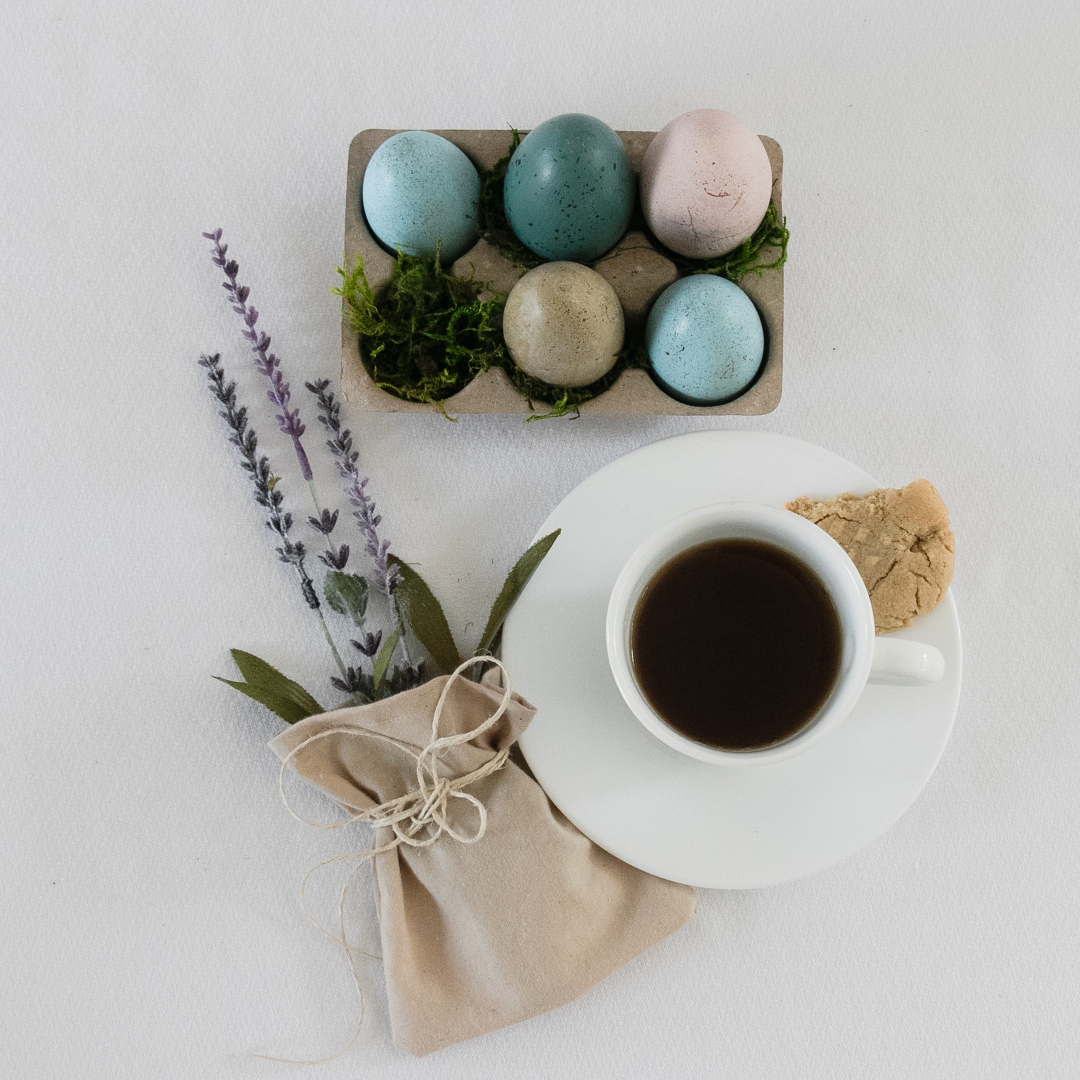Easter eggs, bunch of lavender, cup of coffee and cookie