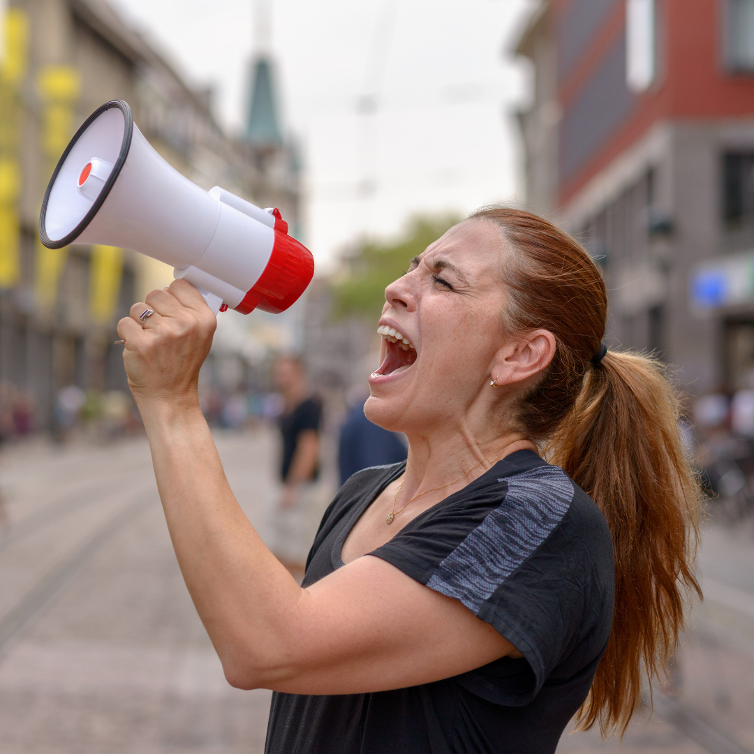 woman shouting into a bullhorn
