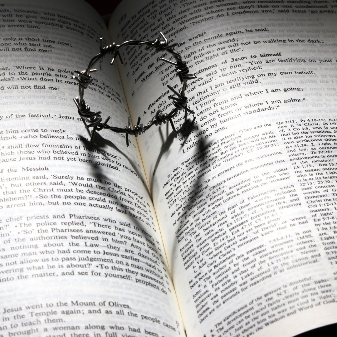 tiny wire crown of thorns on page of the Bible
