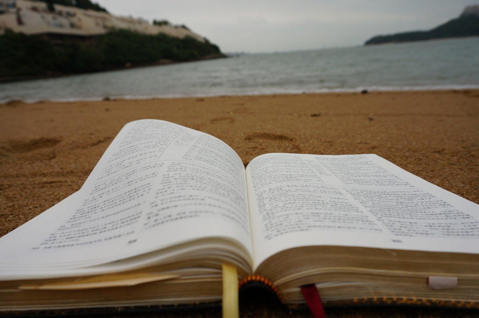 Open Bible on beach