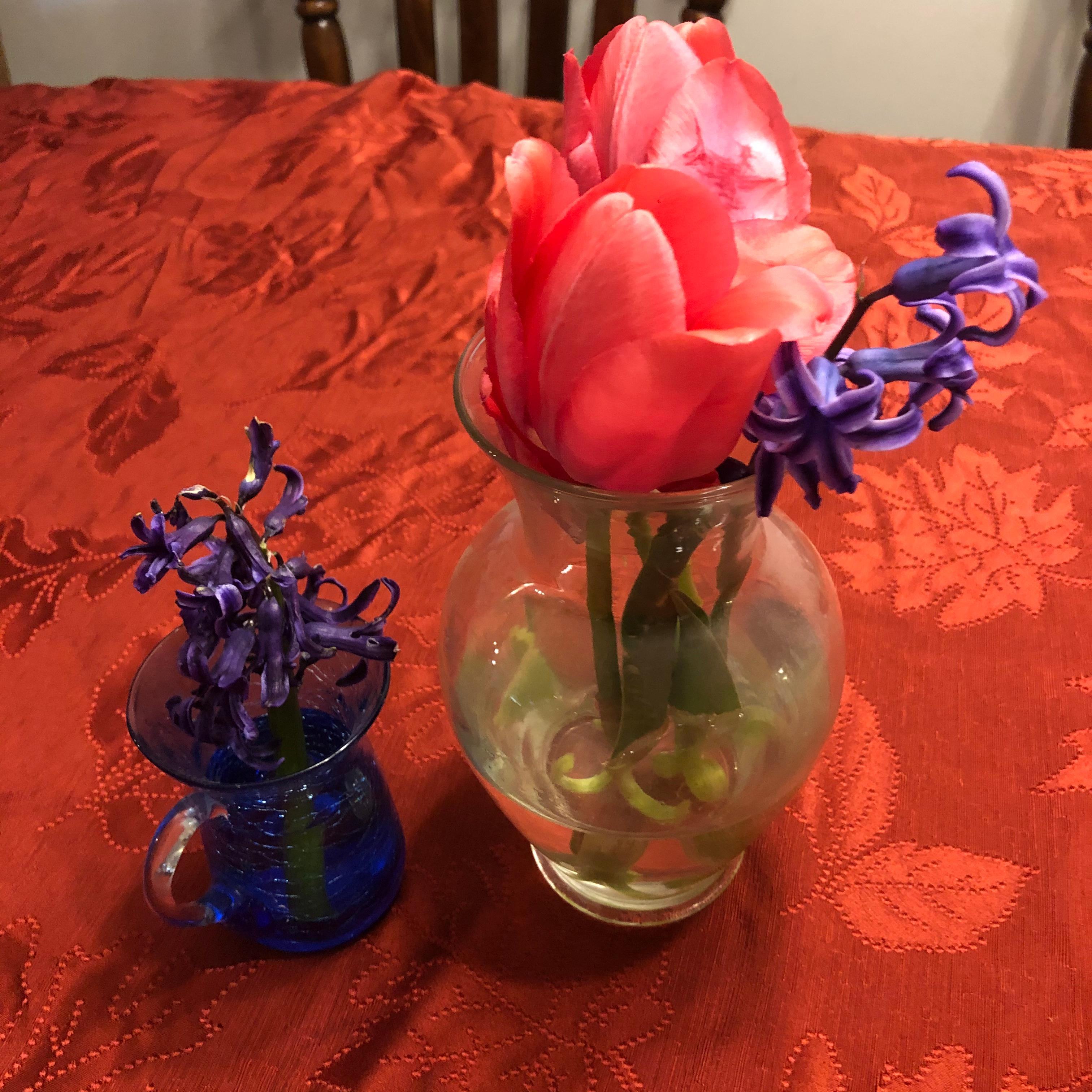 small vases of flowers
