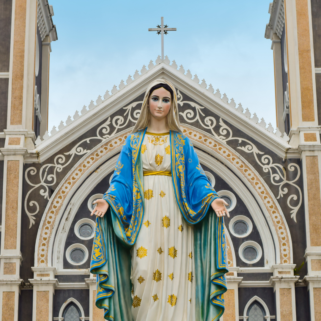 statue of Mary in front of a church