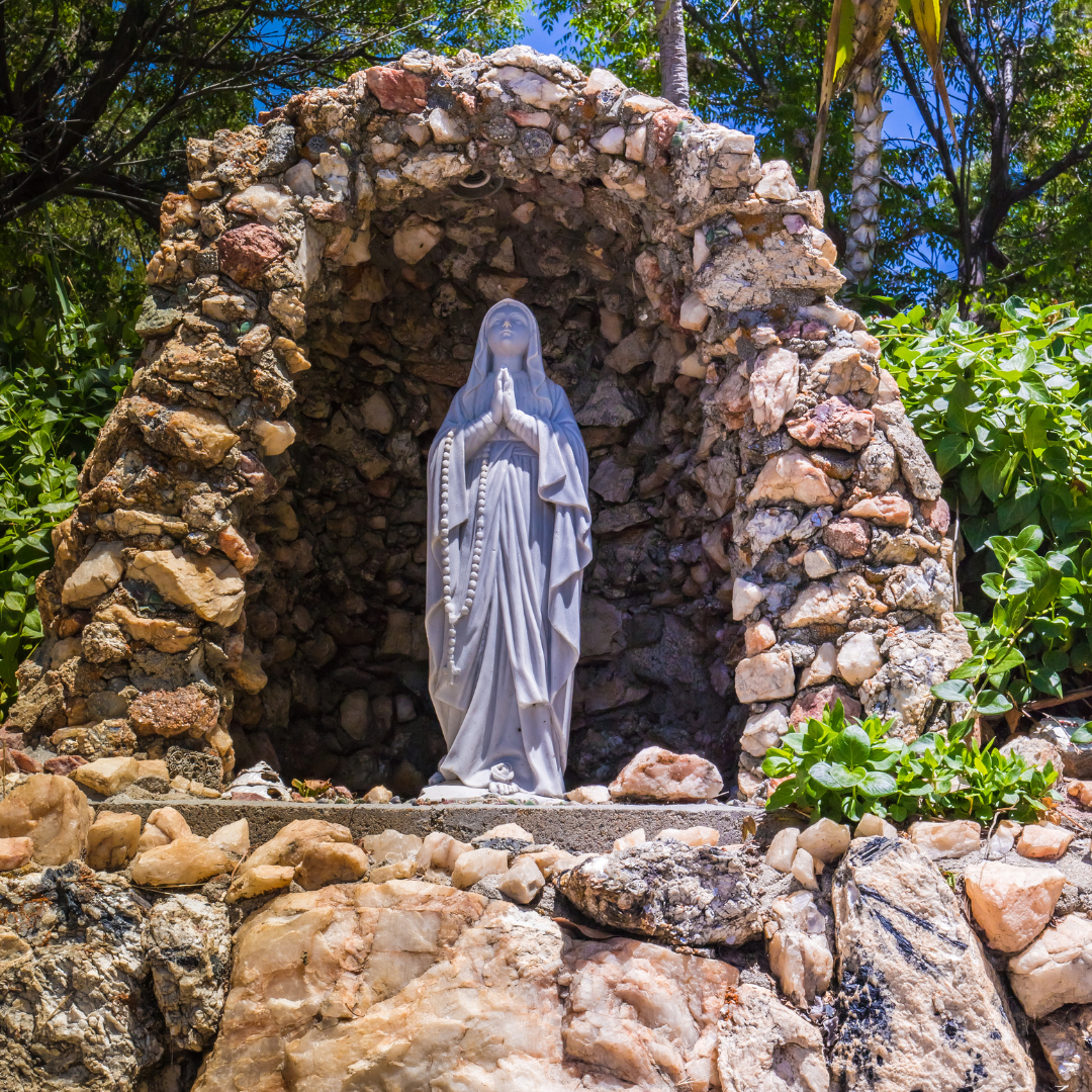 Statue of Our Lady of Lourdes in small grotto