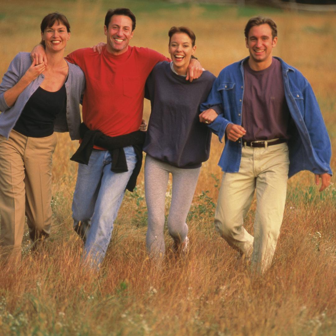 people walking in a field