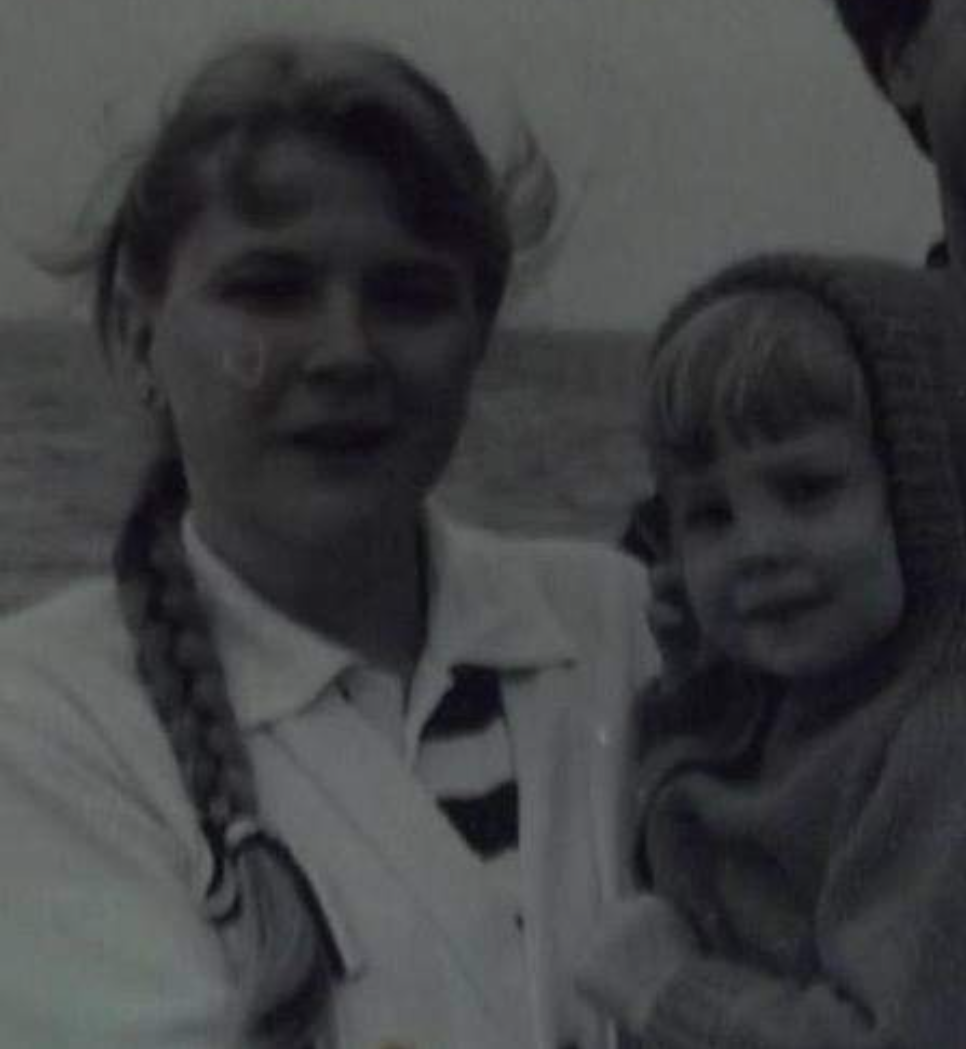 vintage photo of mother holding little girl
