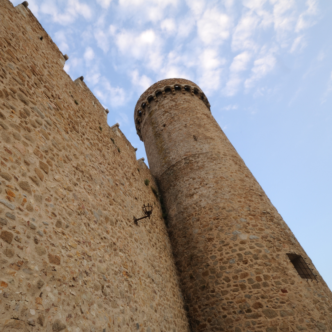 tall fortress wall and tower built of stone