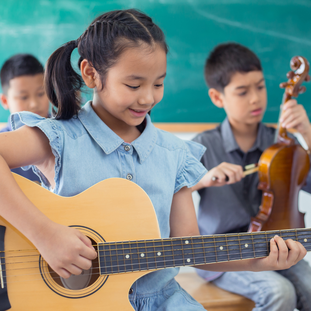 children learning to play guitar and violin