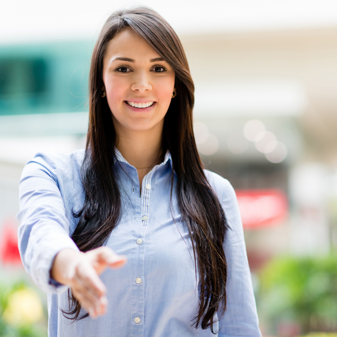 woman reaching out hand in welcome