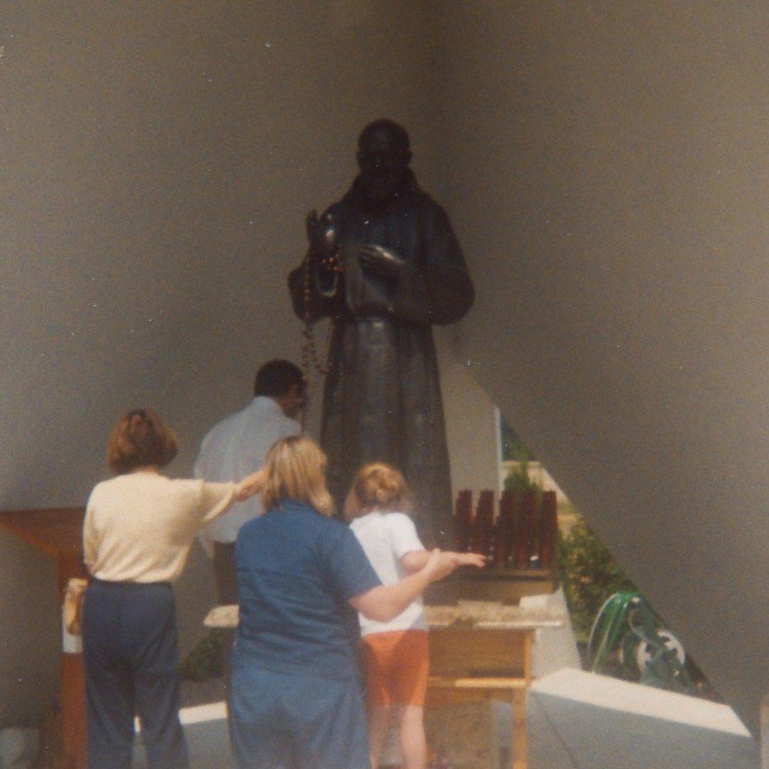 family praying at Padre Pio Shrine