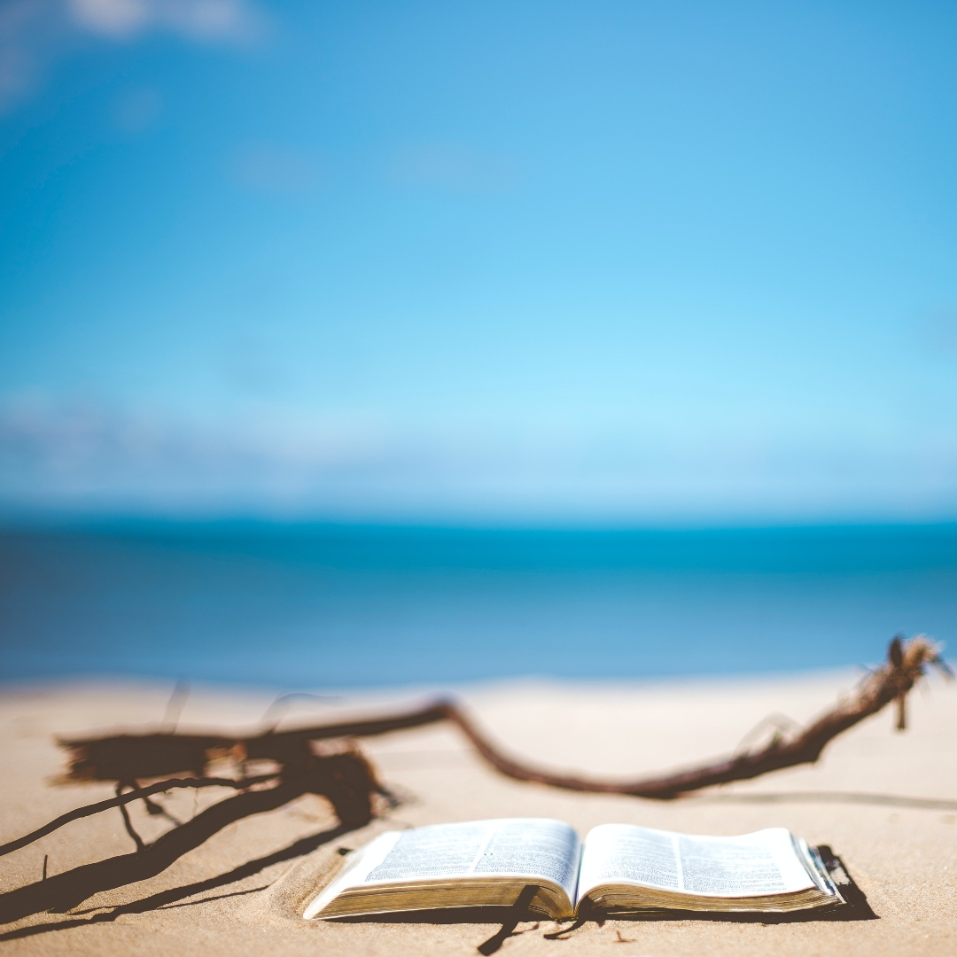 open Bible on the beach
