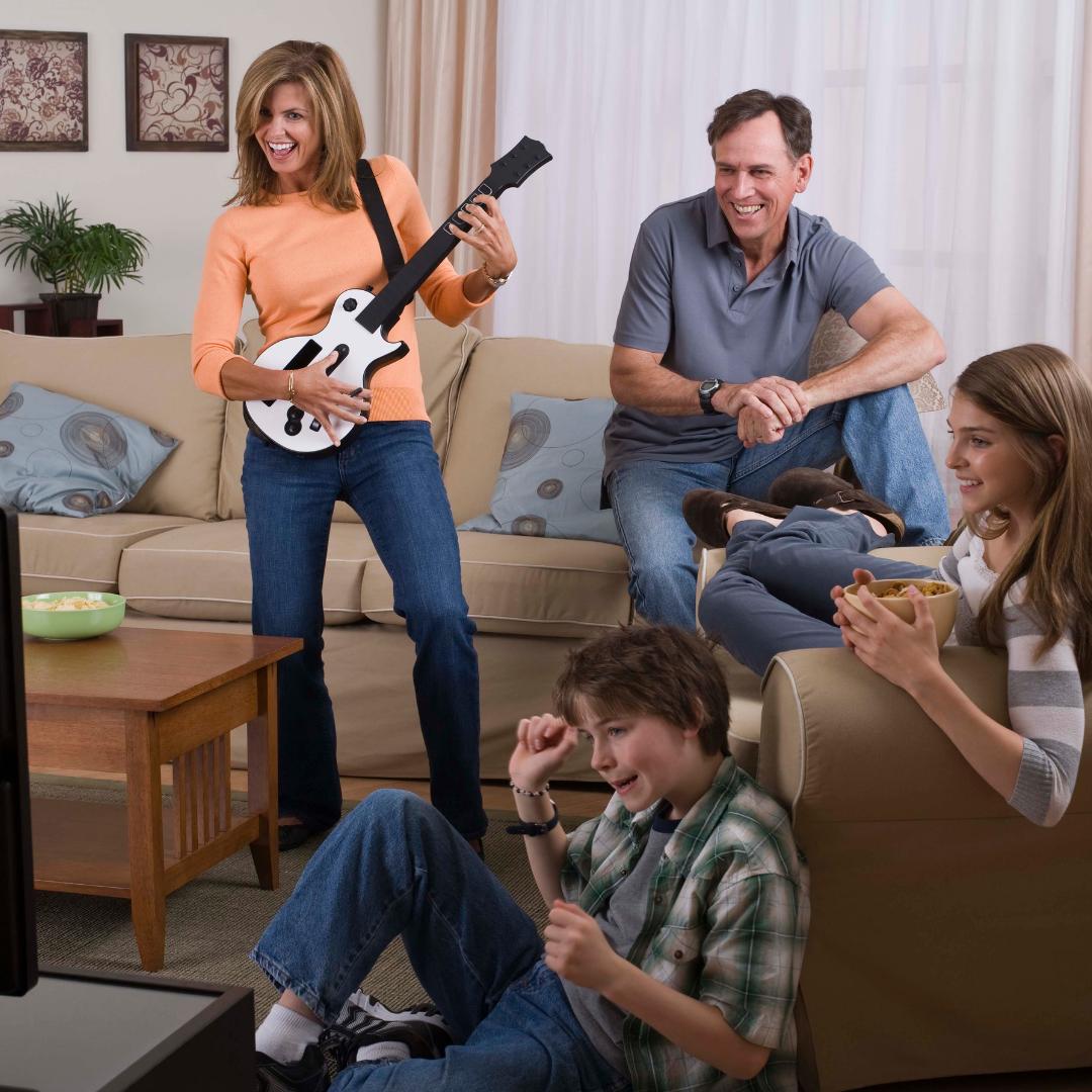 family playing Guitar Hero