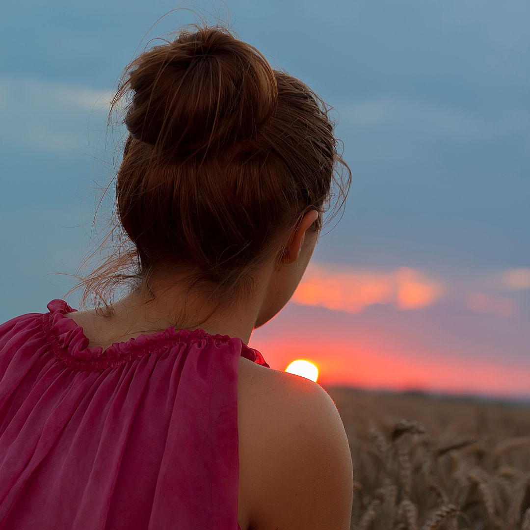 woman looking at a sunset view