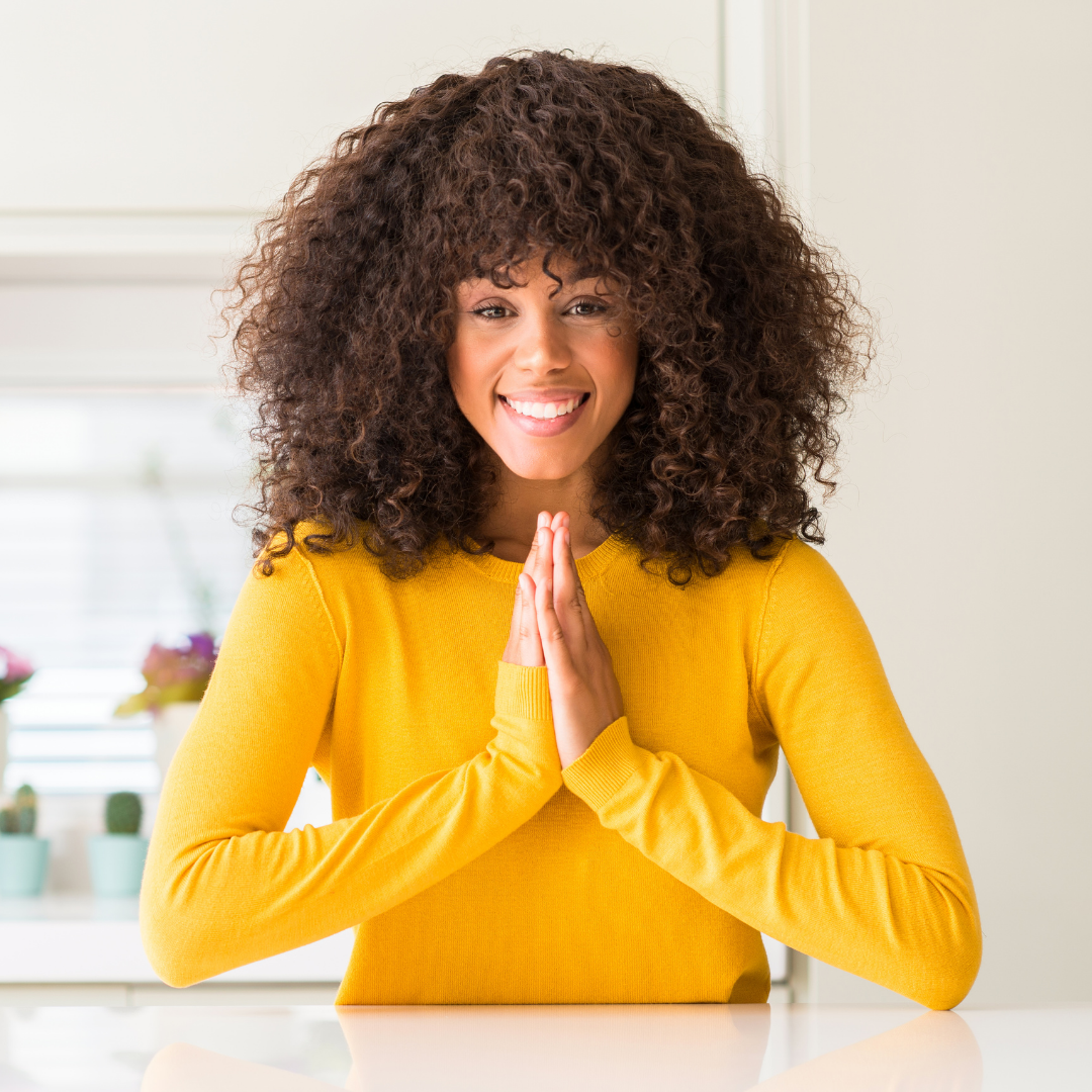 woman with hands in praying position