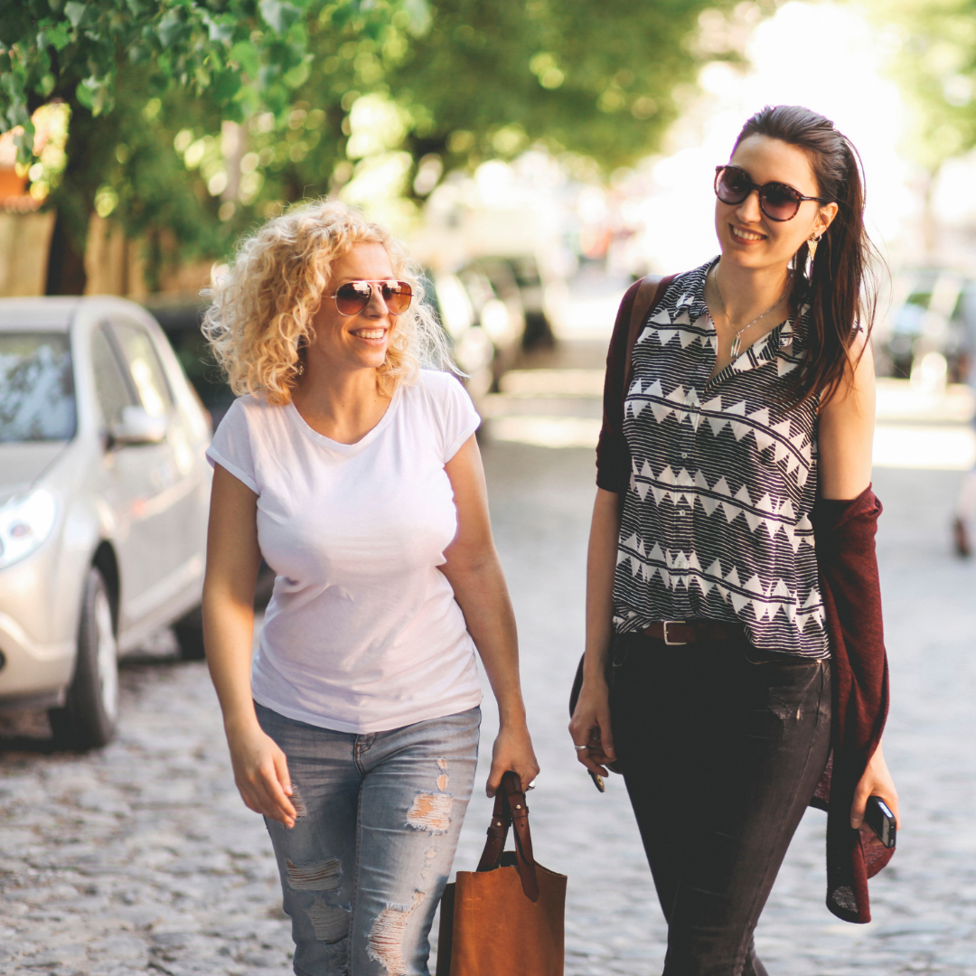 friends walking in the city