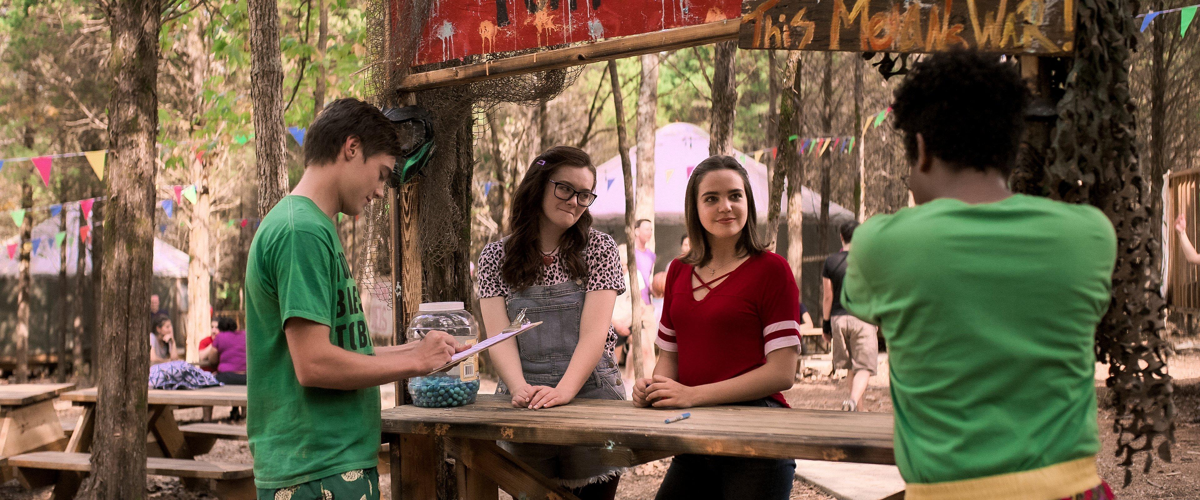 teenagers at craft station at camp