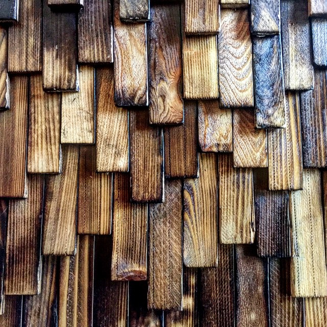 "Photo by Jared Zimmerman:  ""Partial shou-sugi-ban (char preservation) shingles"" (2015) via Flickr, CC BY-NC-ND 2.0."