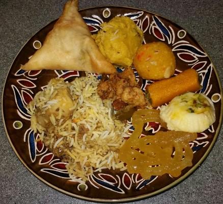 Briyani mutton, samosa, dal, Jalebi and Laddu, by Marianna Bartholomew. All rights reserved.