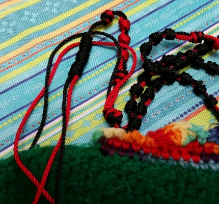 Grandma's hand-knit slipper and my nearly-completed cord Rosary.