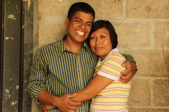 Carlos and Ena share a tender moment at home.
