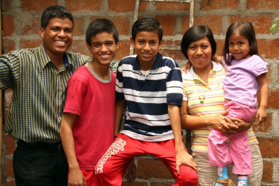 Beautiful smiles fill the home of Carlos (left) and Ena (second from right), shown here with three of their children, Carlos Elias (second from left), Cesar Gabriel (center) and Laura Valeria.