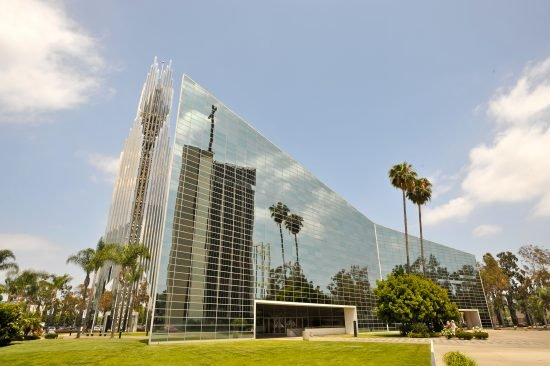 For decades, the Crystal Cathedral stood as a landmark and worldwide center of worship: the largest glass structure in the world comprised of 11,236 glass panels. After filing for bankruptcy, the ministry in 2013 sold the building and adjacent campus to the Roman Catholic Diocese of Orange for its new cathedral. The building now is being renovated to accommodate the Catholic liturgy, formally renamed Christ Cathedral and re-established to serve as the new seat of the Diocese of Orange.