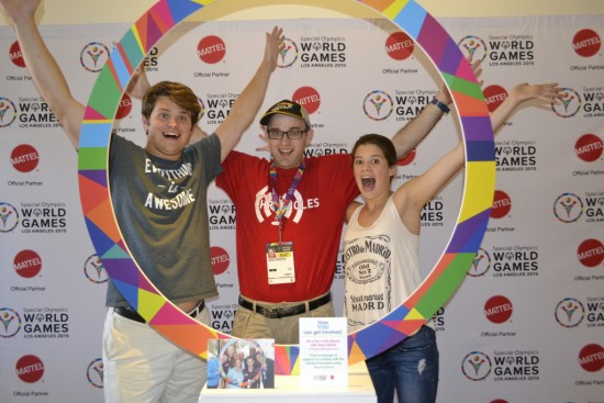 Daniel (center) reaches up for Special Olympics World Games Los Angeles 2015 in the Circle of Inclusion with his friends Sam (left) and Caroline (right) Shriver, grandchildren of Special Olympics founder Eunice Kennedy Shriver. Photo by Daniel Smrokowski/Special Chronicles.