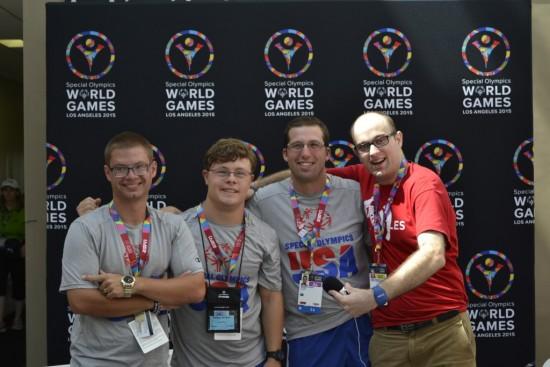 Daniel talks with fellow Special Olympics aquatics athletes from Special Olympics USA. Photo by Daniel Smrokowski/ Special Chronicles