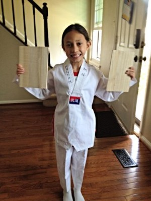"""The closest pic I could get to my daughter, who will be fully initiated at the Easter Vigil. So instead of her baptismal garment, she is dressed in her white Tae Kwan Do uniform """"breaking the chains of death."""""""