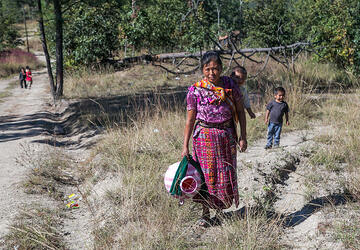 Cristina Garcia and her family walk to get water for drinking, cooking and cleaning. Photo by Phil Laubner/CRS
