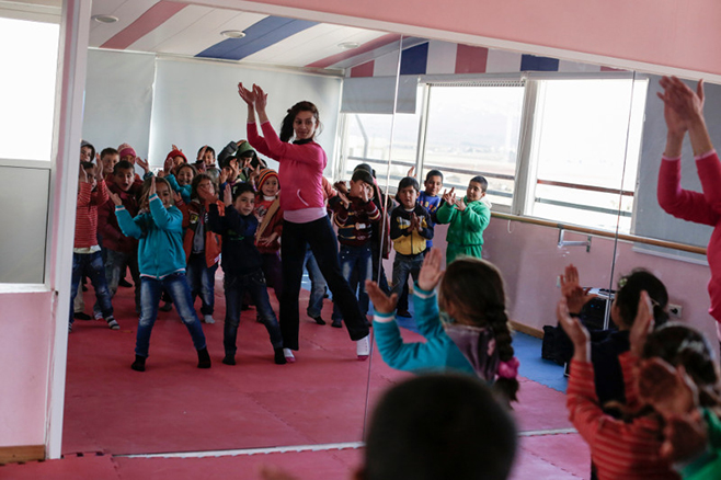 The CRS-supported Good Shepherd Sisters center in Deir al Ahmar, in Lebanon's Bekaa Valley, provides a range of classes—including dance—to some 350 refugee children, as well as a daily hot meal for every child. Photo by Sam Tarling for CRS