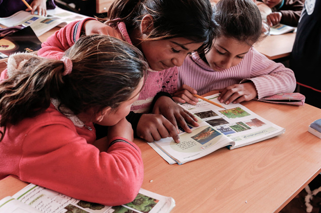Students, from left, Zainab, 10, and Ola and Evine, 12, attend science class at the Good Shepherd Sisters center. These refugees fled Syria's Idlib and Aleppo provinces for Lebanon, where the winter has been harsh. Besides schooling, the sisters provide children with winter clothes and meet other critical needs. Photo by Sam Tarling for CRS