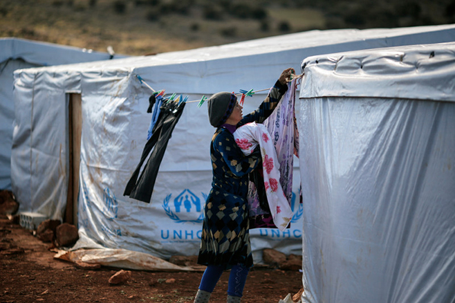 Abir, a Syrian mother of two, fled her home in Raqqa 11 months ago. Just before a recent snowstorm, the sisters helped refugees like Abir get sturdy tents from the United Nations High Commissioner for Refugees. Photo by Sam Tarling for CRS