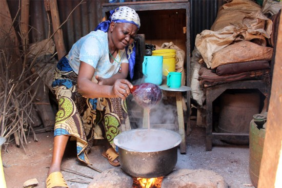Lucy makes Uji, a type of porridge common in Kenya. Photo copyright 2015 Unbound. All rights reserved.
