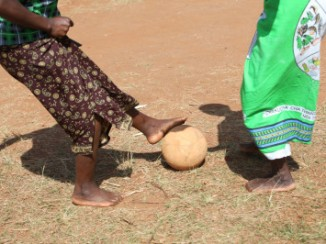 Members of a WALA care support group play soccer outside the community center in their village Tholo, Malawi. The group uses soccer as a fun way to promote key messages about health, hygiene and nutrition to the greater community. Photo by Sara A. Fajardo/CRS