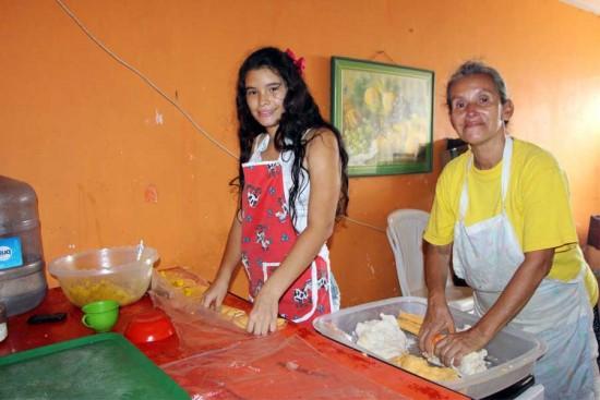 Nathalie helps her mother, Martha, make empanadas. Photo copyright 2016 Unbound. All rights reserved.