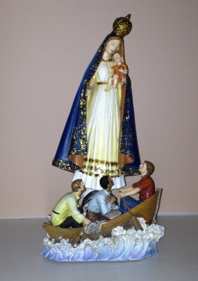Our Lady of Charity keeps me company in my office.