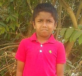 Hopat lives in India, loves to draw and play soccer, and helps his family with chores.