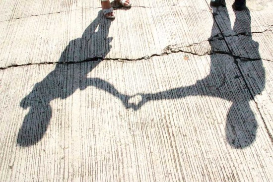 Children in the Philippines make a heart with their hands. Photo copyright 2015 Unbound. All rights reserved.