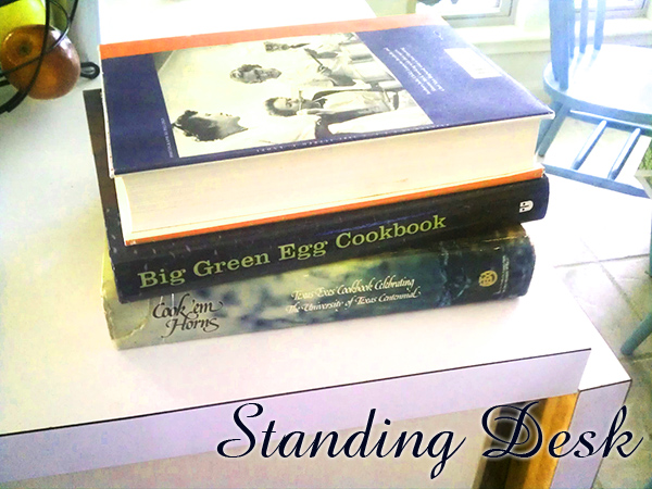 Create a standing desk with books on a countertop