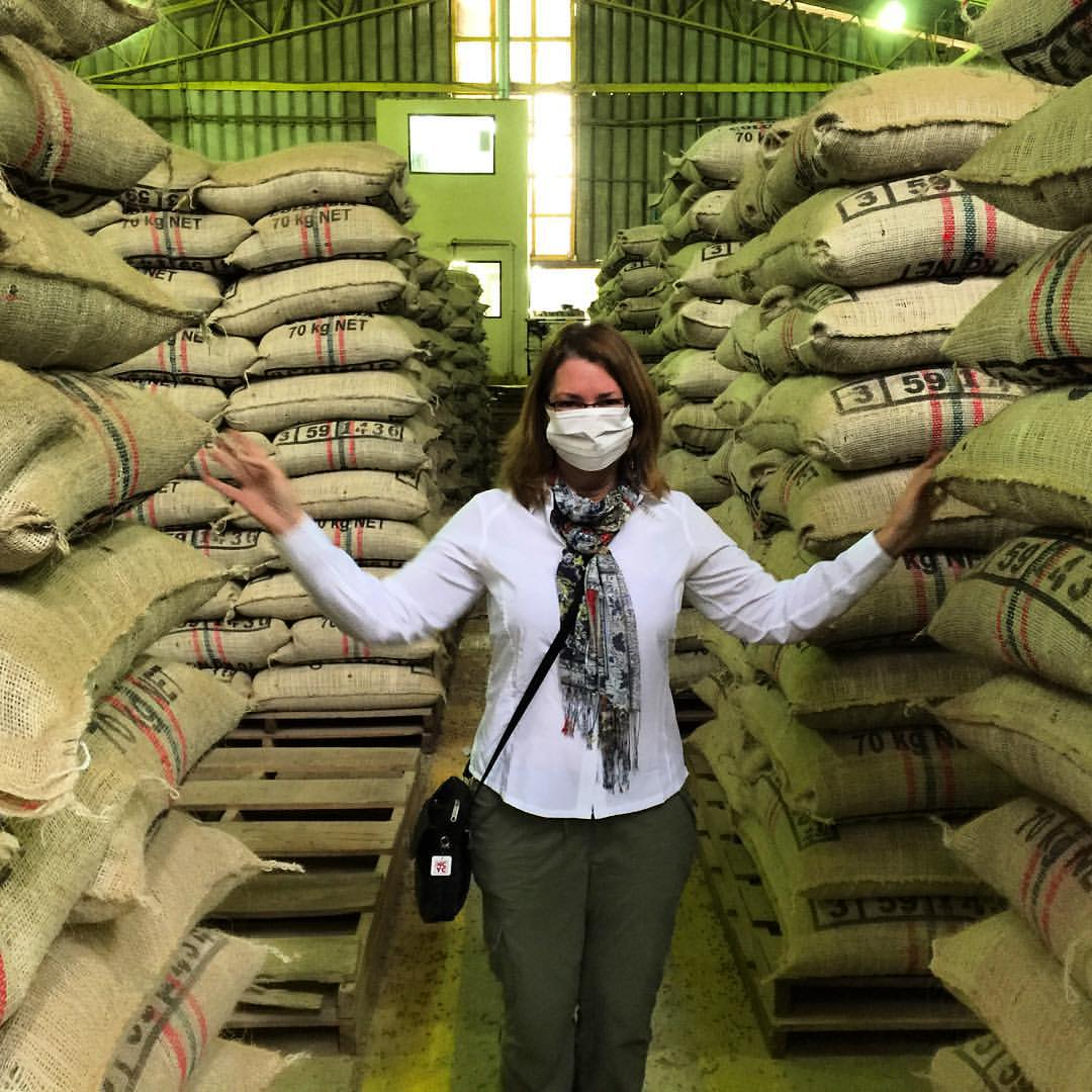 Surrounded by bags of Colombian coffee in the Carcafe dry mill.