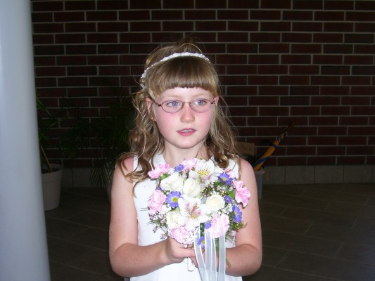 dan first communion with flowers