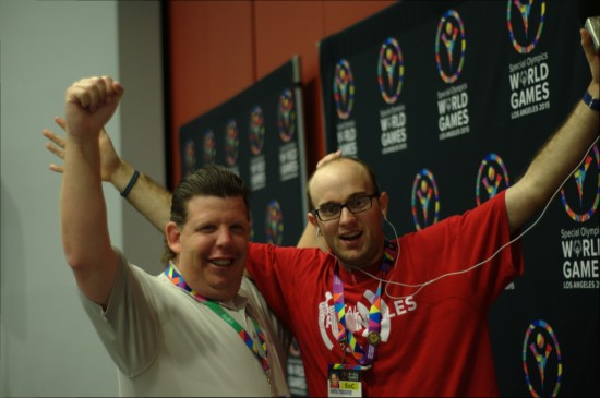 Daniel (right) and Dustin (left) reach up for Special Olympics World Games Los Angeles 2015 after a press conference on July 24. Photo by Daniel Smrokowski/Special Chronicles.