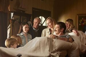 (L to R:) Hudson Meek (Chris Piper), Bobby Baston (Joe Piper), Elizabeth Hunter (Nicole Piper), David Clyde Carr (Eva's Dad), Kate Bosworth (Eva Piper), Hayden Christensen (Don Piper) and Catherine Carlen (Eva's Mom), welcome Don home from his 13-month hospital stay in a scene from 90 MINUTES IN HEAVEN, from Giving Films, LLC, releasing Sept. 11, 2015. (Photo credit: Quantrell Colbert) - Image used with permission