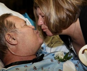 Russell Campion and Jan Schroeder kiss after exchanging wedding vows at the Nebraska Medical Center.